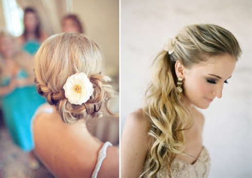 braid updo with flower and half up wavy wedding hairstyle