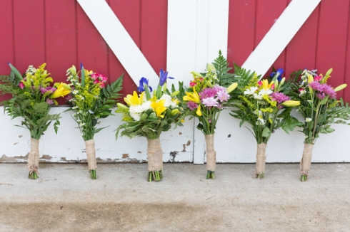 cheery colorful wedding bouquet barn doors