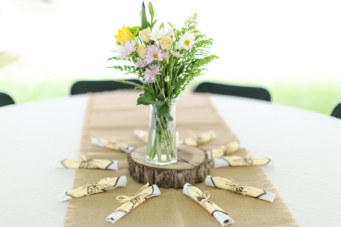 simple flower centerpiece log slice